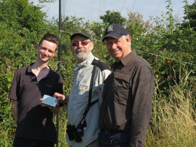 Steve Collins, Vice-Chairman of the Essex Birdwatching Society handing over a cheque to David, accompanied by Mark Bridges the outgoing warden at EWT Two Tree Island
